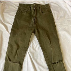 Olive green skinny ripped jeans